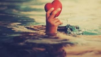 Holding-heart-300x292